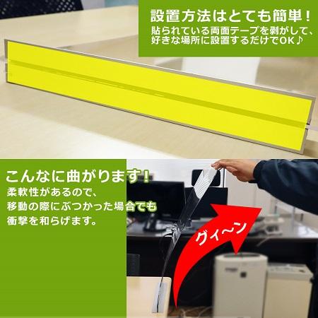 飲食店のカウンター用感染対策アクリル板衝立の安全性を説明するため曲げられるところを撮影し説明している画像